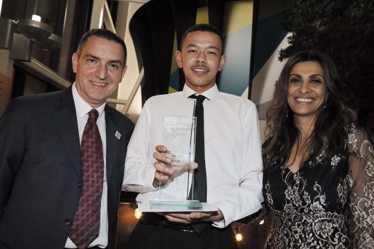 Callum Hixon holding The Darren Cooper Award