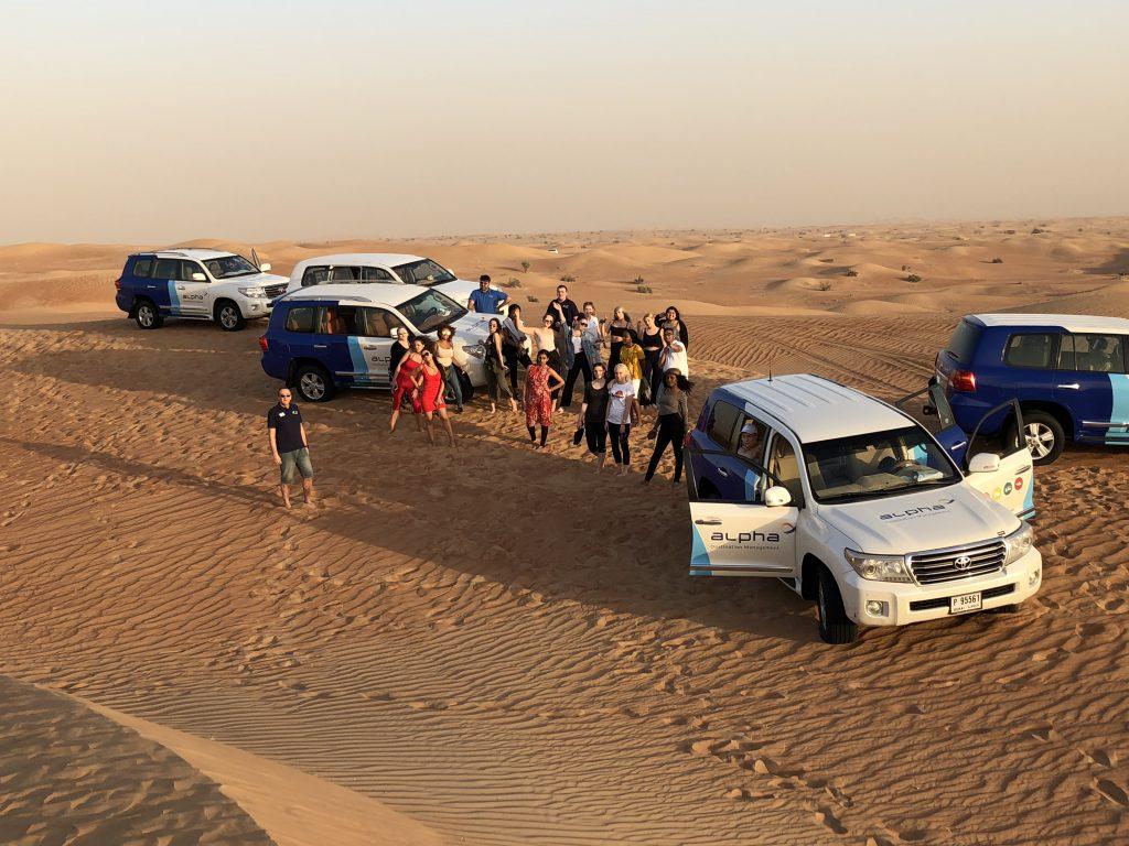 Travel students in Dubai desert