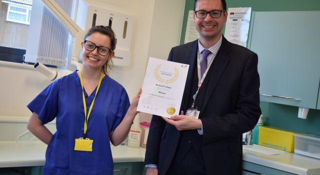 Apprentice receiving her certificate