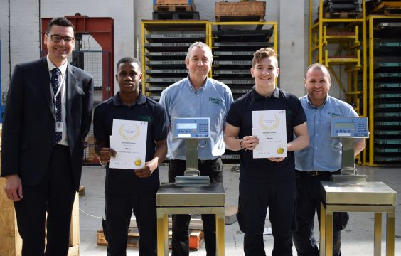 Apprentices receiving their certificate