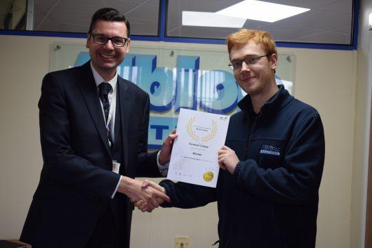 Apprentice receiving his certificate