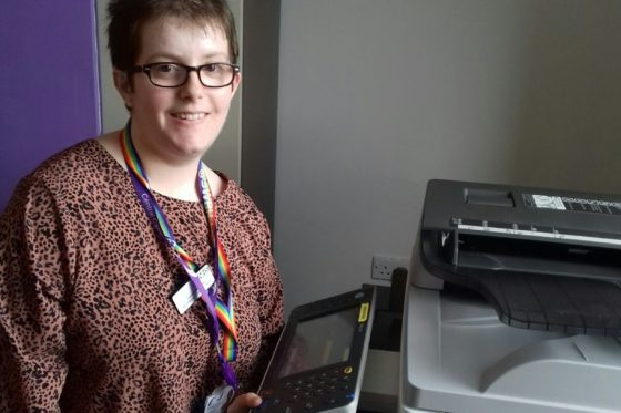 Foundation Learning student pictured next to printer