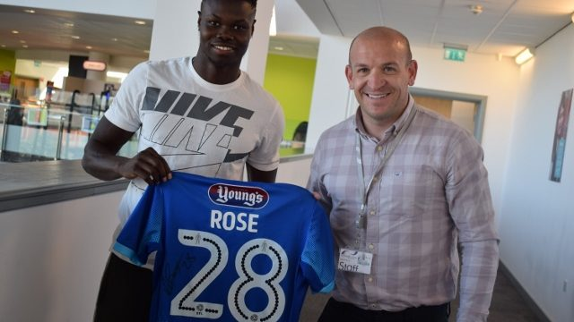 Sport lecturer pictured with former sport student Ahkeem