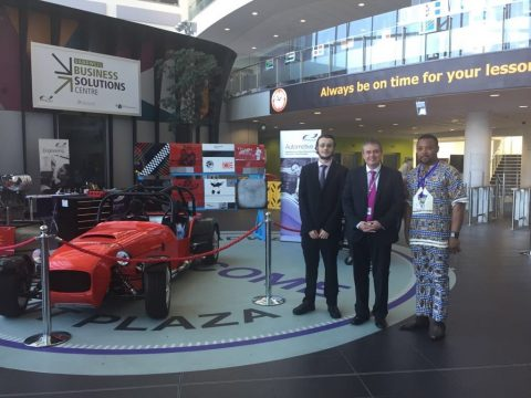 Principal Graham Pennington pictured with School Council Members stood next to Grass Racer