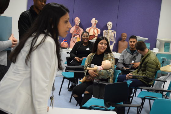 Health and Social Care lecturer speaking to class of students