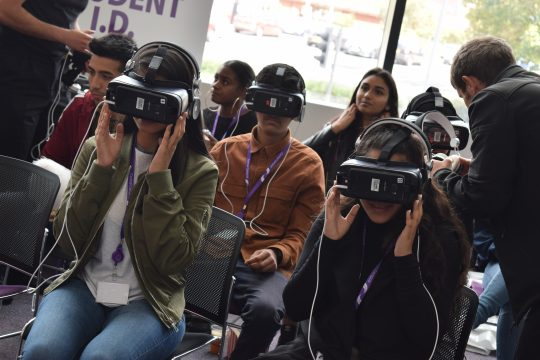 Students wearing Virtual Reality equipment