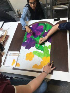 Art students painting mural