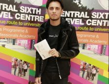 Sameer Qadeer pictured with his results