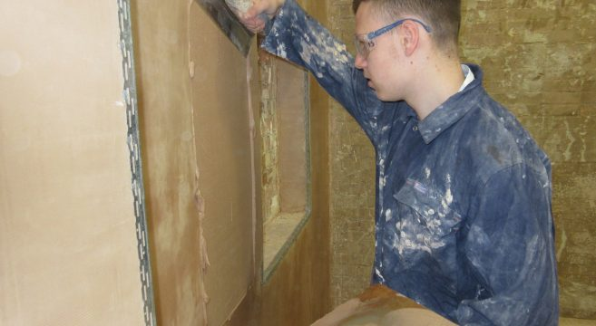 Plastering student in a workshop