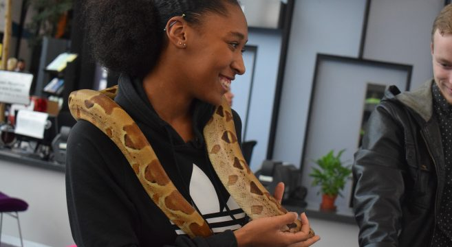 Student with snake around her shoulders