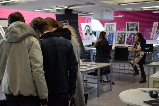 Group of students viewing art exhibition