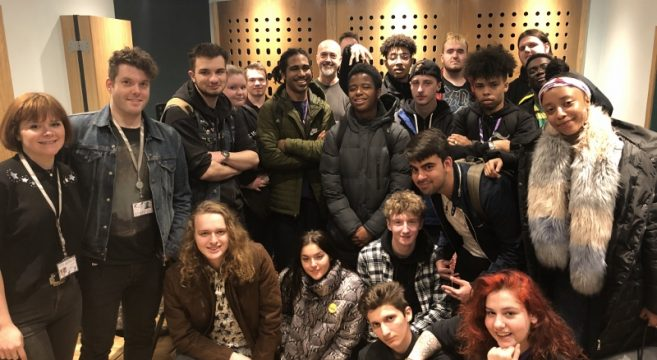 Students in music studio with music producer