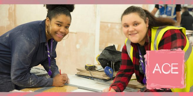 Two female construction students in a workshop