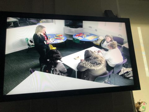 CCTV footage of group of students and teacher