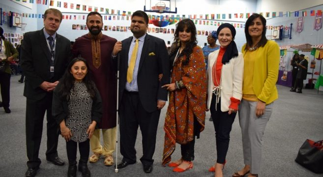 Group of staff members celebrating One World event