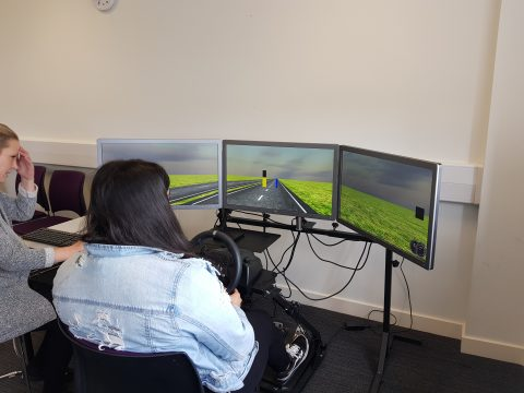 Student participating in a Driving simulation