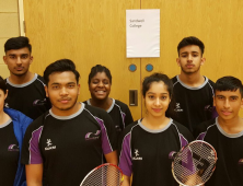 Group of male and female badminton players