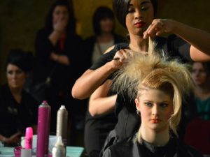 Hairdressing student cutting hair