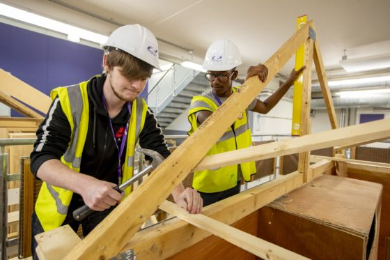 Two students in a woodwork class