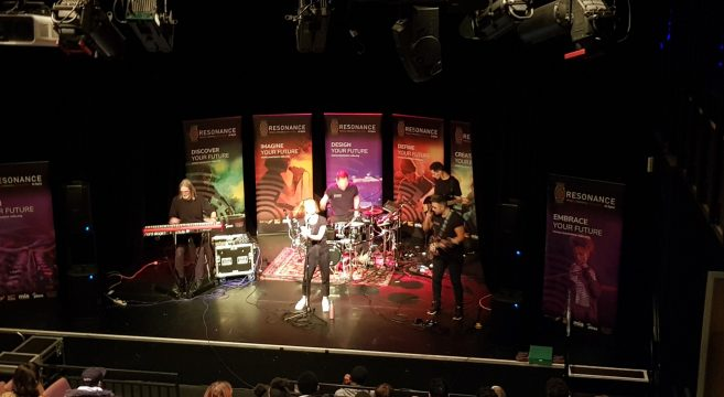 Music band performing in the theatre