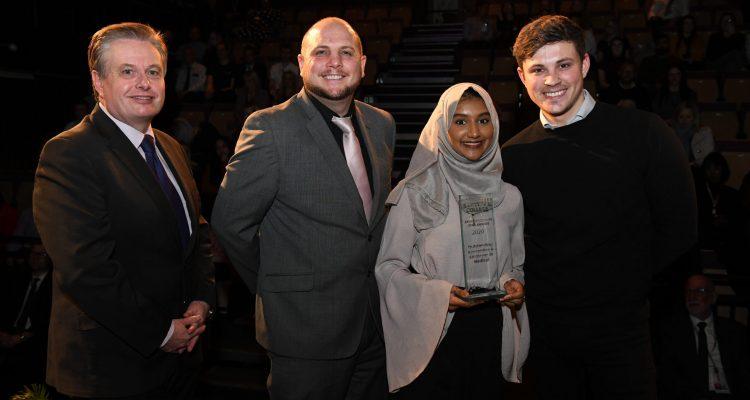 Student receiving award from Graham Pennington, Councillor Danny Millard and James Brown