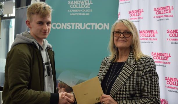 Construction student Adam presented with £100 giftcard by CECA regional director