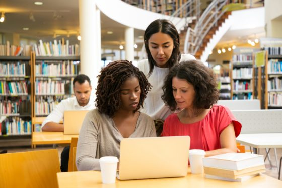 Focused students working over new project at library