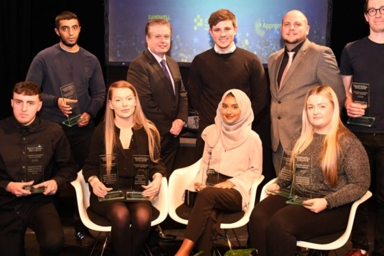 Group photo of apprentices with their awards