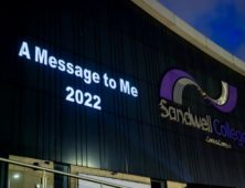 A Message to Me 2022 projected onto college building