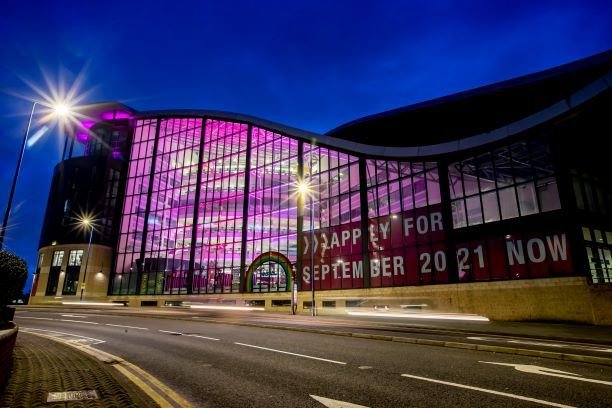 Sandwell College lit up in pink