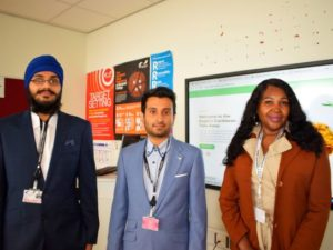 Two male computing students with female employer