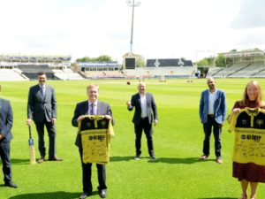 College and club managers holding signed shirts at Edgbaston cricket ground