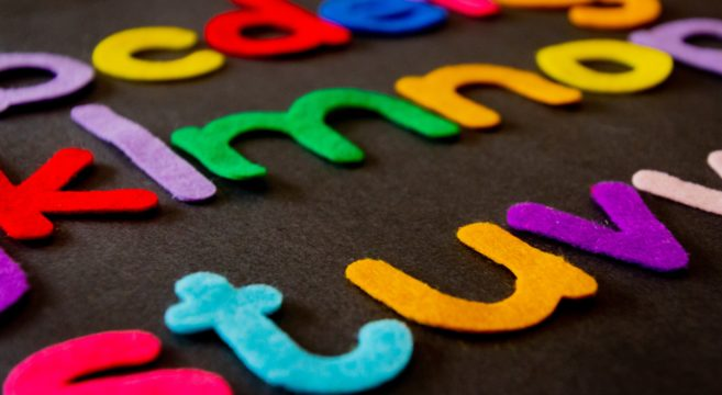 Coloured alphabet letters on a black background