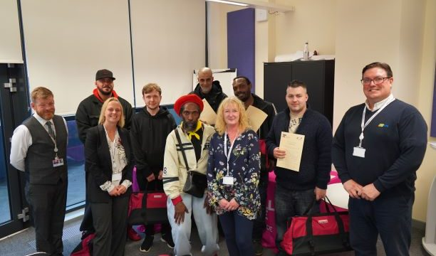 Adult construction learners with their certificates
